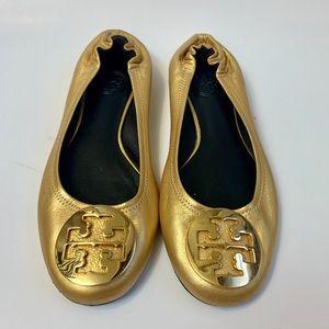Gold Tory Burch medallion ballerina flats